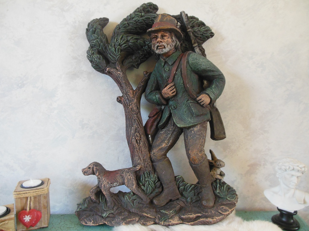 Metal wall decoration depicting a hunter with his dog, tree and rabbit made by Mat Wanders.