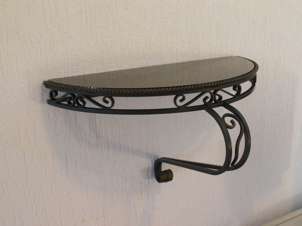 Amazing wrought iron wall console table with glass top.