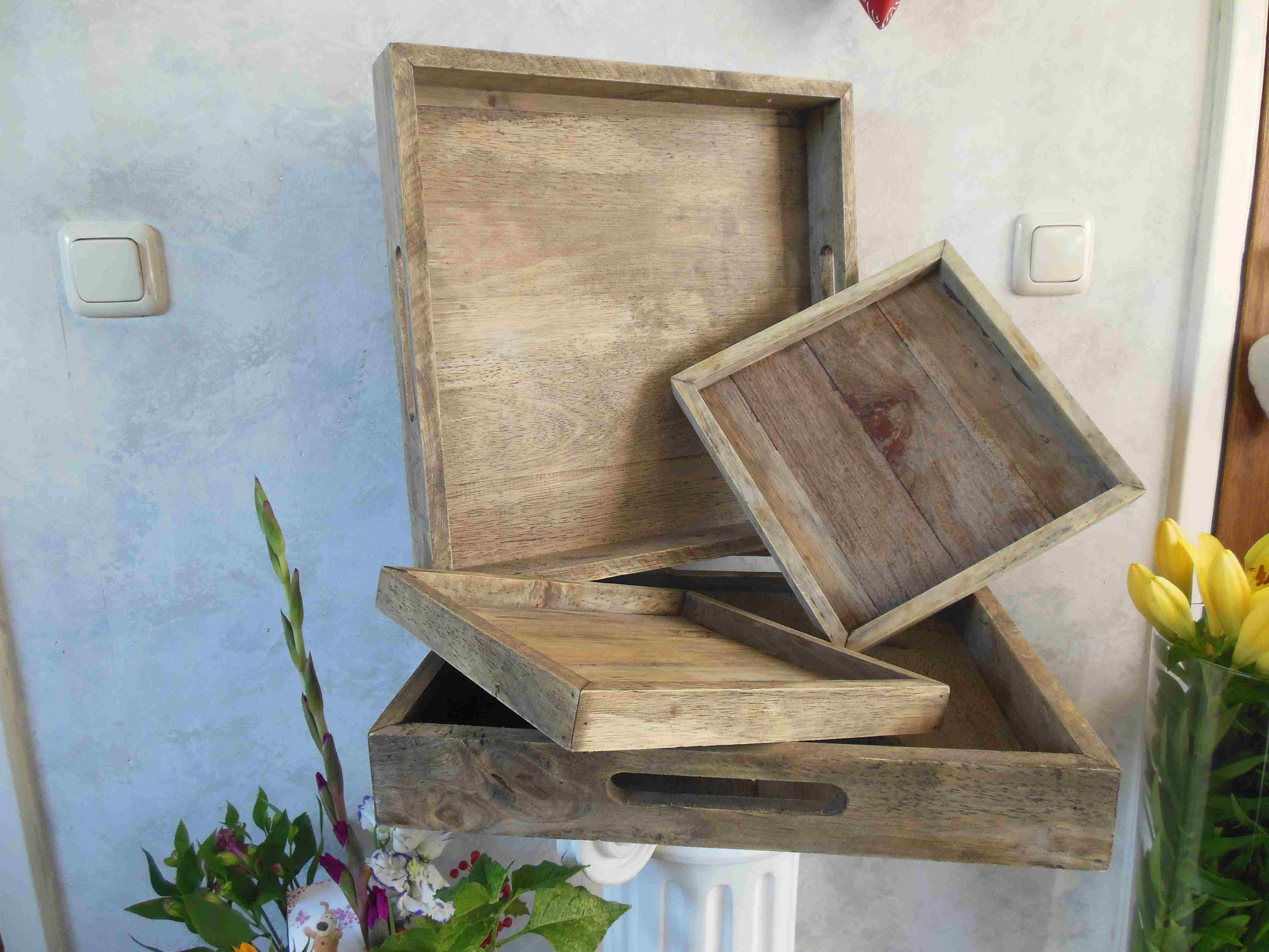 Multiple completely wooden serving trays or decorative trays in two sizes.