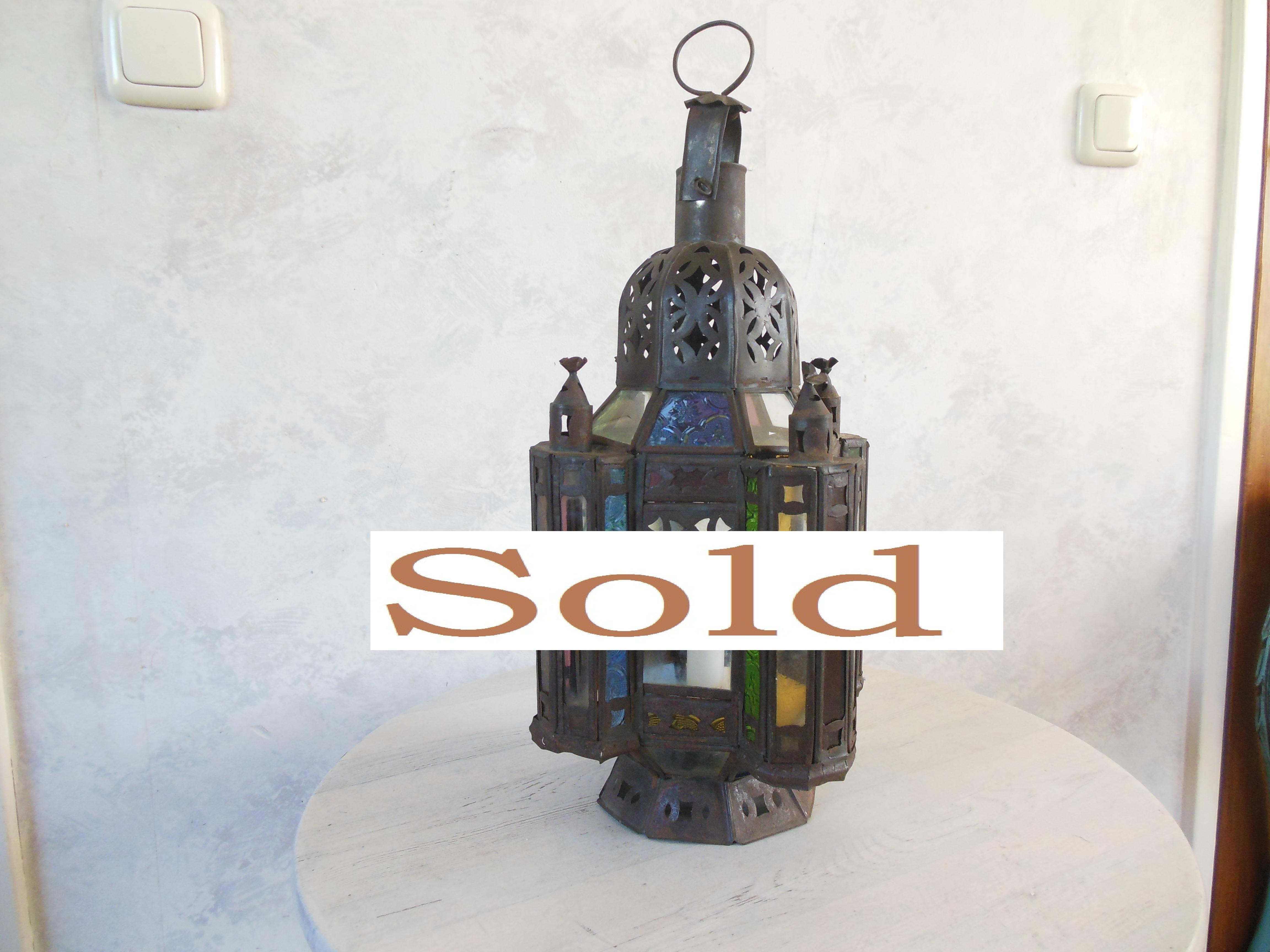 Beautiful metal oriental lantern with colored and carved glass.