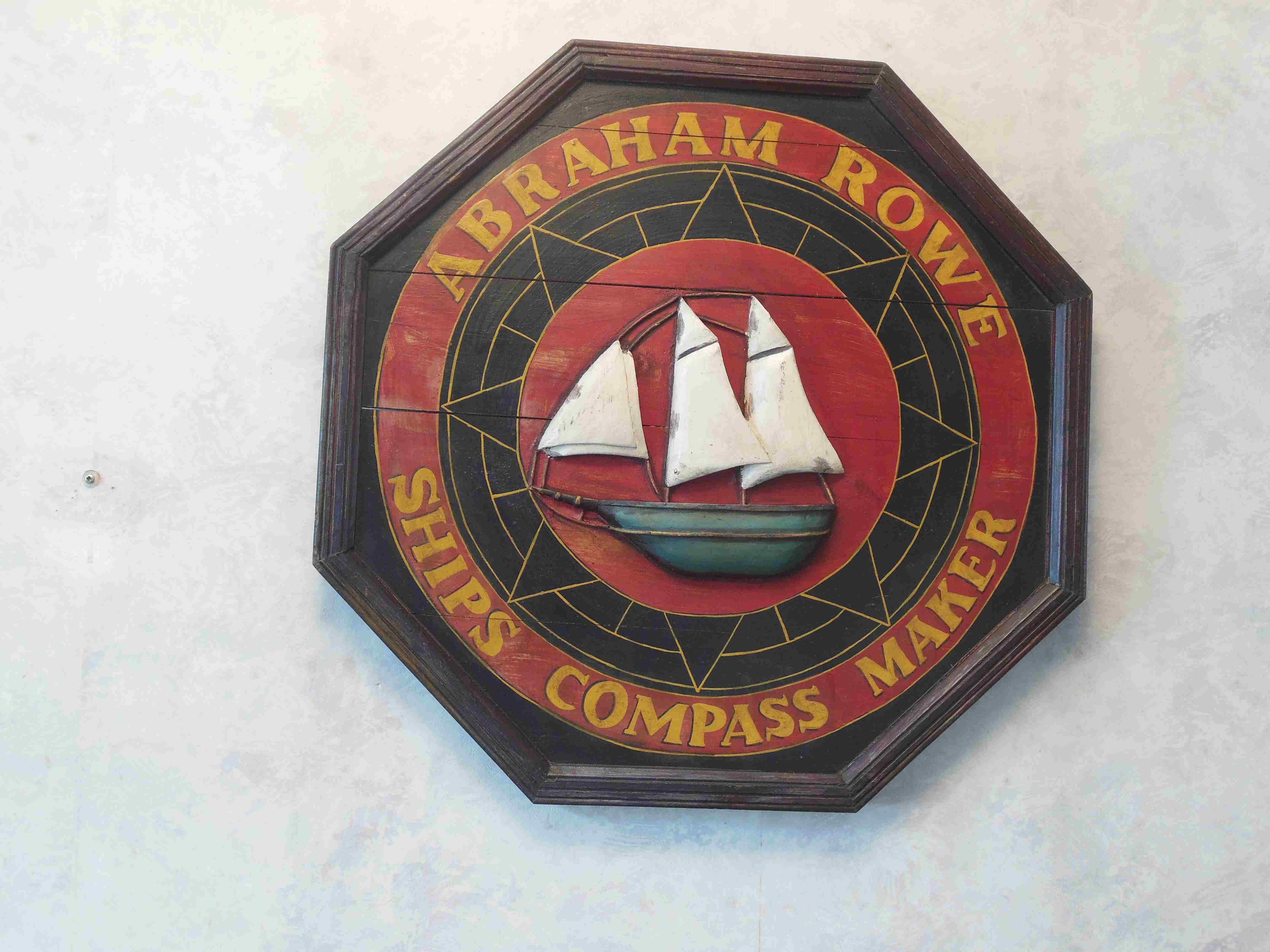 Nice wooden billboard with 3D image of a sailing ship with the inscription Abraham Rowe - Ships compass maker.
