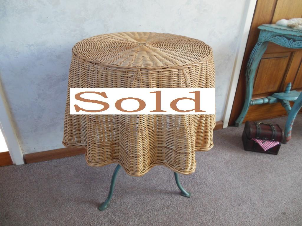 Beautifully handwoven skirted wicker Trompe l'Oeil draped skirt side table.