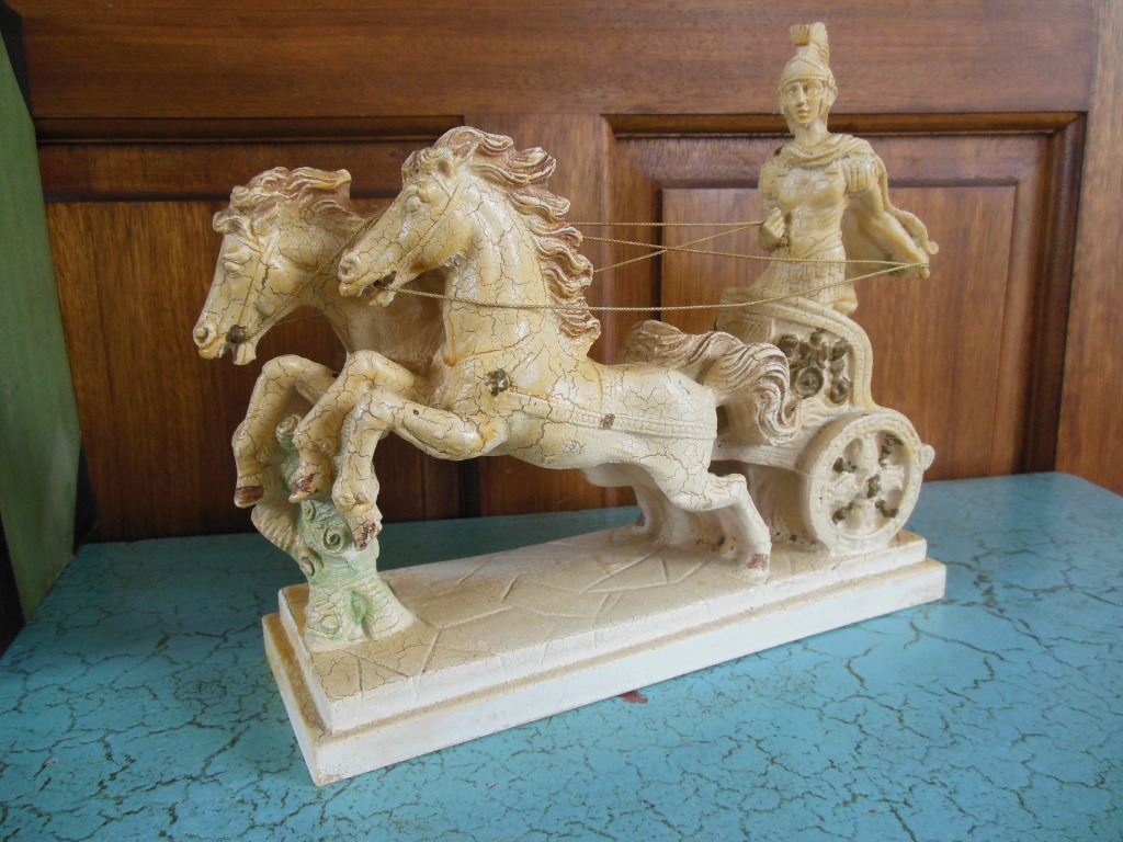 Roman on chariot or biga with two horses.