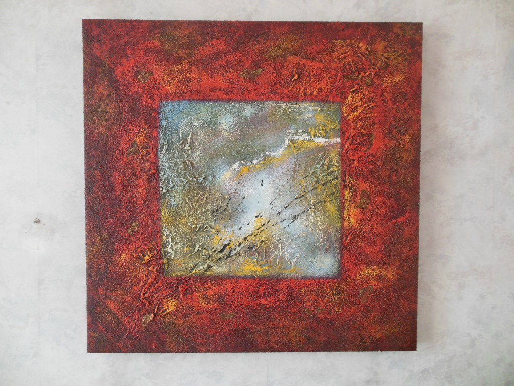 Beautiful abstract painting in warm colors with pieces of gold leaf in the red border.