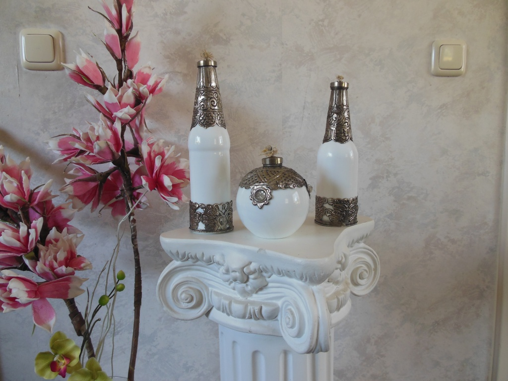Loverly set white glass oil lamps with metal decoration.