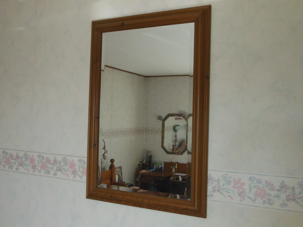 Beautiful mirror with cut glass.
