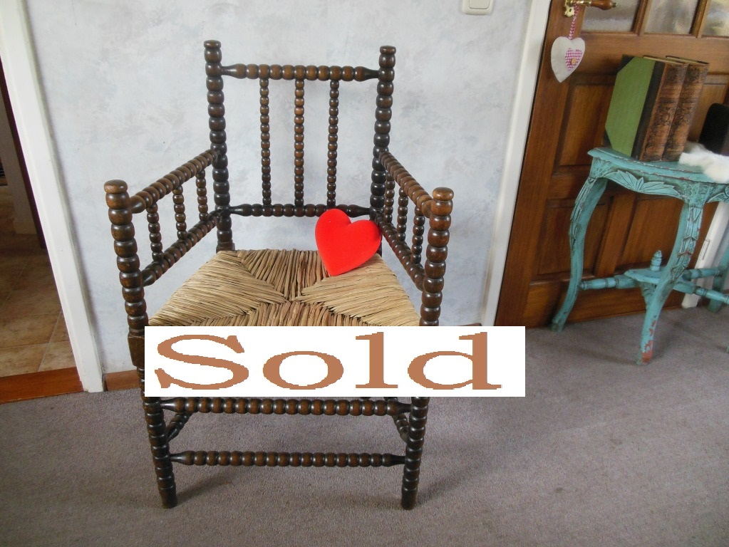 Antique bobbin chair with rush seat.