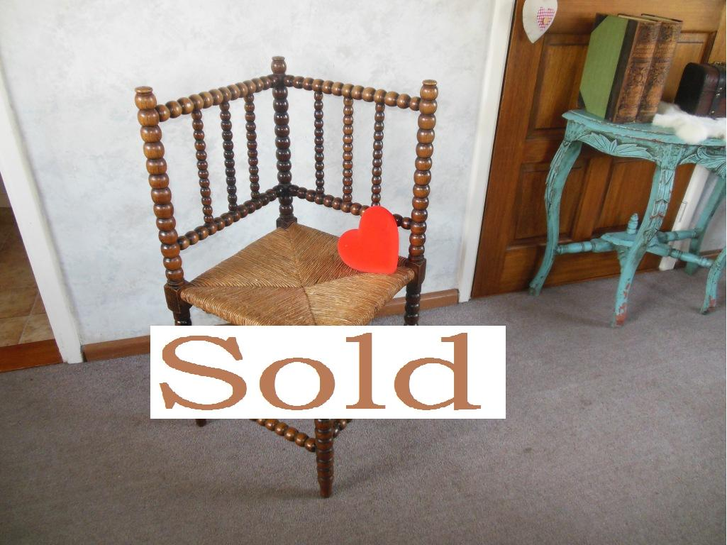 Antique bobbin corner chair with rush seat.