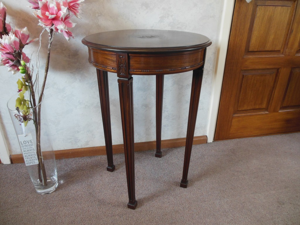 Gorgeous mahogany table in Empire style.